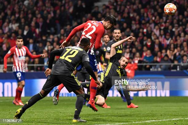 Atletico Madrid's Spanish forward Alvaro Morata heads the ball during the UEFA Champions League round of 16 first leg football match between Club...