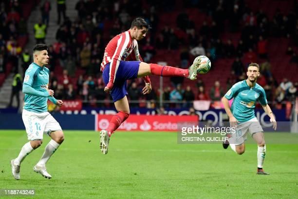 Atletico Madrid's Spanish forward Alvaro Morata kicks the ball during the Spanish League football match between Club Atletico de Madrid and CA...
