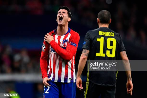 Atletico Madrid's Spanish forward Alvaro Morata reacts after missing a goal opportunity during the UEFA Champions League round of 16 first leg...