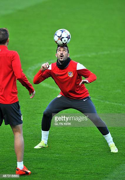 Atletico Madrid's Spanish forward David Villa controls the ball during a training session at Stamford Bridge in London on April 29 on the eve of the...