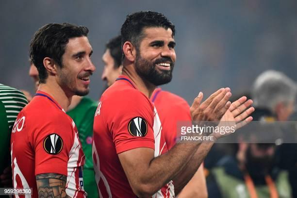 Atletico Madrid's Spanish forward Diego Costa and Atletico Madrid's Croatian defender Sime Vrsaljko celebrate after the UEFA Europa League final...