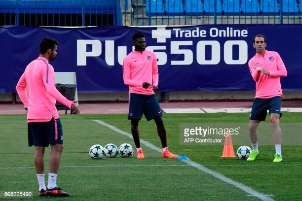 Atletico Madrid's Spanish forward Diego Costa Atletico Madrid's Ghanaian midfielder Thomas and Atletico Madrid's Uruguayan defender Diego Godin take...