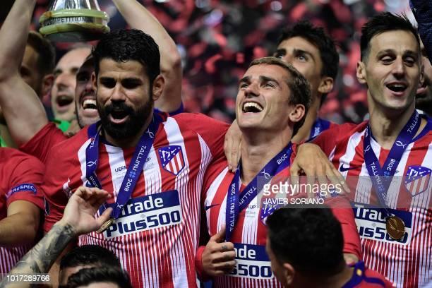 Atletico Madrid's Spanish forward Diego Costa, Atletico Madrid's French forward Antoine Griezmann and Atletico Madrid's Croatian forward Niko Kalinic...