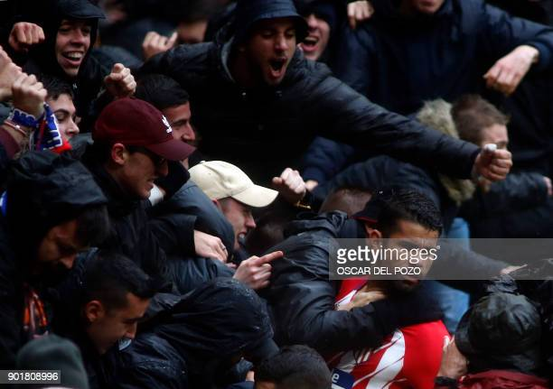 Atletico Madrid's Spanish forward Diego Costa celebrates a goal with supporters during the Spanish league football match Club Atletico de Madrid vs...