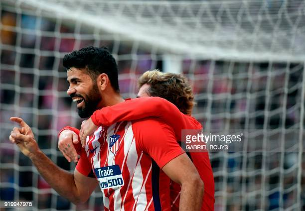 Atletico Madrid's Spanish forward Diego Costa celebrates a goal with Atletico Madrid's French forward Antoine Griezmann during the Spanish league...