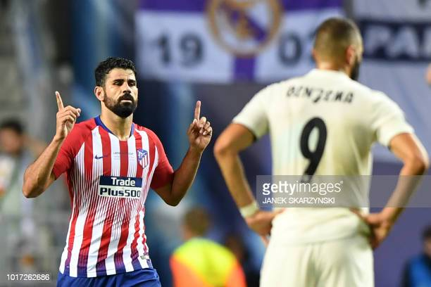 TOPSHOT Atletico Madrid's Spanish forward Diego Costa celebrates after scoring a second goal during the UEFA Super Cup football match between Real...