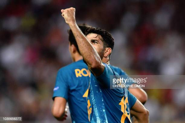Atletico Madrid's Spanish forward Diego Costa celebrates after scoring a goal during the UEFA Champions League first round football match between AS...