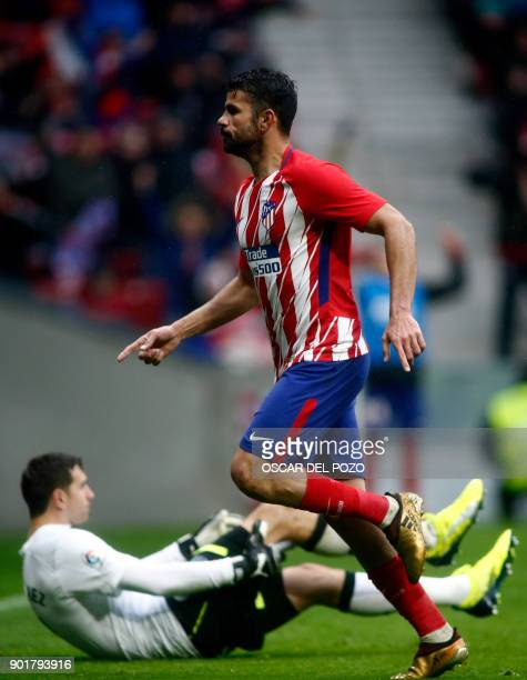 Atletico Madrid's Spanish forward Diego Costa celebrates after scoring a goal during the Spanish league football match Club Atletico de Madrid vs...