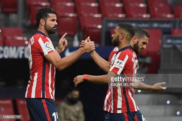 Atletico Madrid's Spanish forward Diego Costa celebrates his goal during the Spanish league football match between Club Atletico de Madrid and Elche...