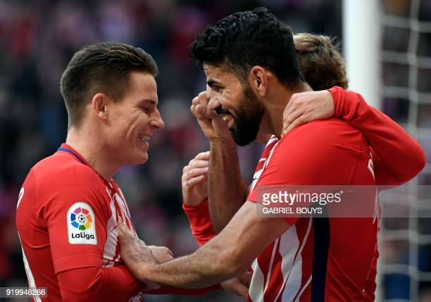 Atletico Madrid's Spanish forward Diego Costa celebrates scoring a goal with Atletico Madrid's French forward Kevin Gameiro during the Spanish league...