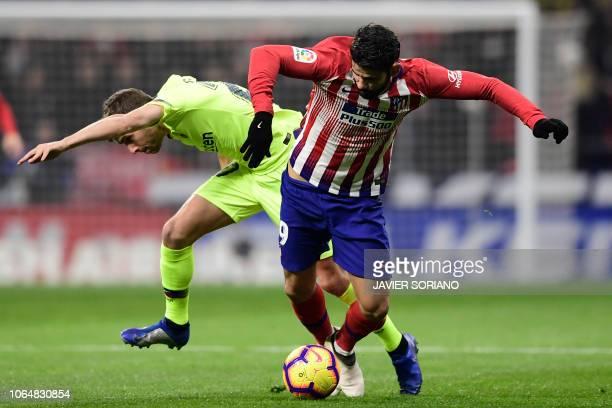 Atletico Madrid's Spanish forward Diego Costa challenges Barcelona's Spanish midfielder Sergi Roberto during the Spanish league football match...