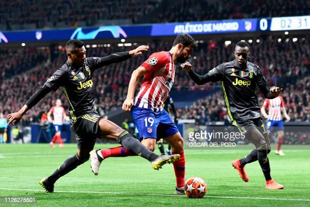 Atletico Madrid's Spanish forward Diego Costa challenges Juventus' French midfielder Blaise Matuidi and Juventus' Brazilian defender Alex Sandro...