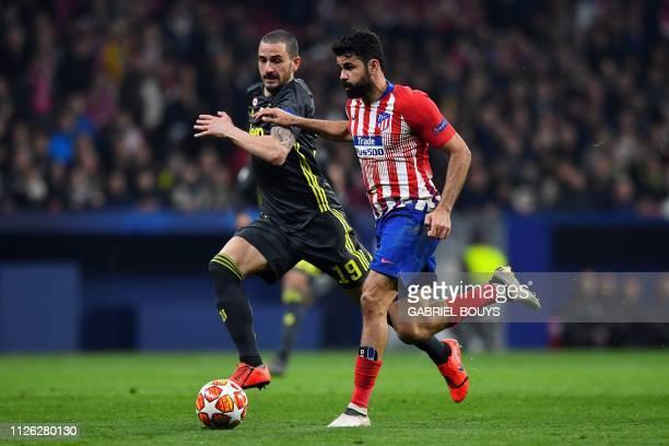 Atletico Madrid's Spanish forward Diego Costa challenges Juventus' Italian defender Leonardo Bonucci during the UEFA Champions League round of 16...