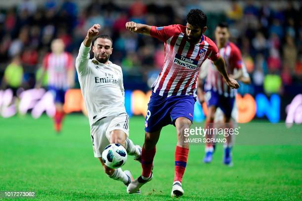 Atletico Madrid's Spanish forward Diego Costa challenges Real Madrid's Spanish defender Dani Carvajal during the UEFA Super Cup football match...