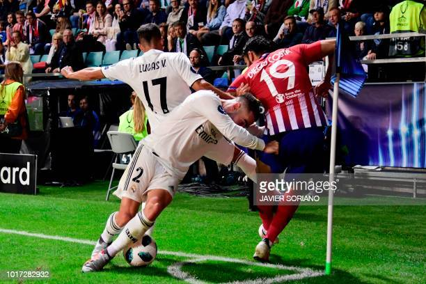 Atletico Madrid's Spanish forward Diego Costa challenges Real Madrid's Spanish midfielder Lucas Vazquez and Real Madrid's Spanish defender Dani...