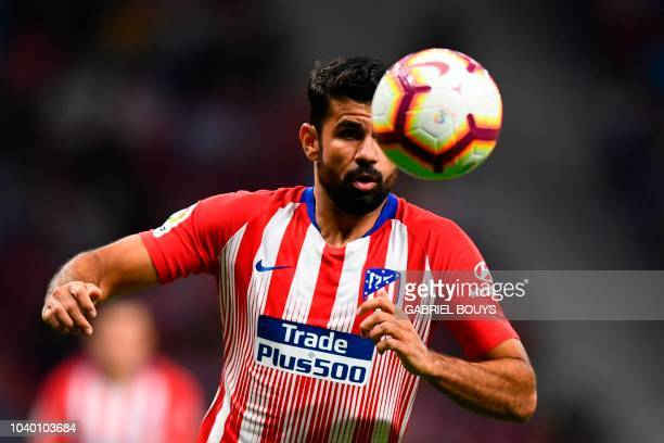 Atletico Madrid's Spanish forward Diego Costa eyes the ball during the Spanish league football match Club Atletico de Madrid against SD Huesca at the...
