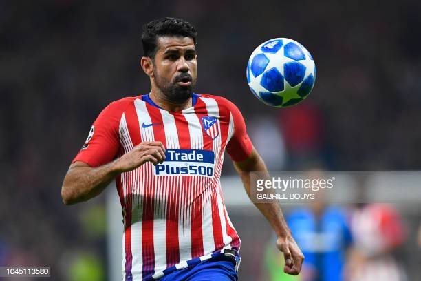 Atletico Madrid's Spanish forward Diego Costa eyes the ball during the UEFA Champions League group A football match between Club Atletico de Madrid...
