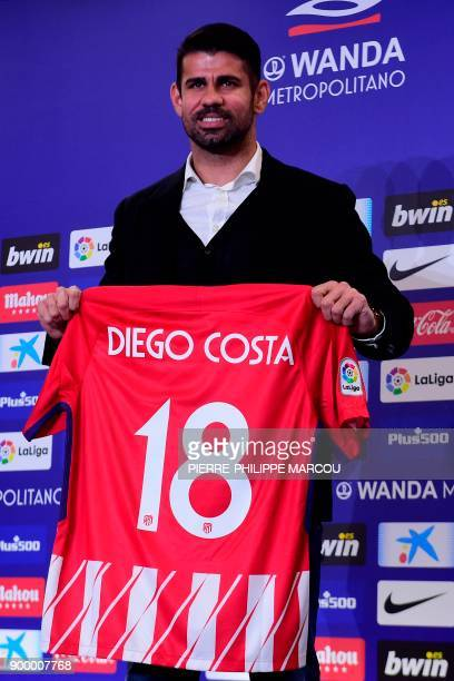 Atletico Madrid's Spanish forward Diego Costa poses with his jersey during his welcoming ceremony at the Wanda Metropolitan Stadium in Madrid on...