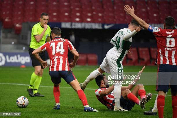 Atletico Madrid's Spanish forward Diego Costa protests on the ground after being fouled during the Spanish league football match between Club...