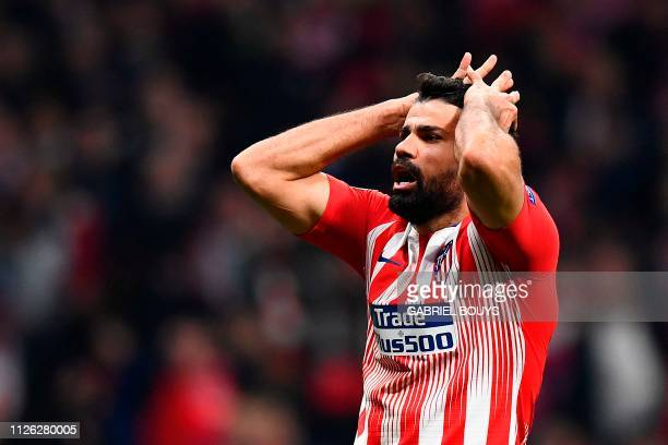 Atletico Madrid's Spanish forward Diego Costa reacts after missing a goal opportunity during the UEFA Champions League round of 16 first leg football...