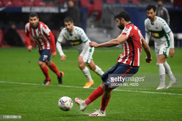 Atletico Madrid's Spanish forward Diego Costa shoots a penalty kick and scores a goal during the Spanish league football match between Club Atletico...