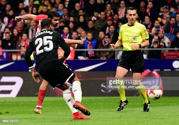 Atletico Madrid's Spanish forward Diego Costa shoots to score a goal during the Spanish 'Copa del Rey' football match between Club Atletico de Madrid...