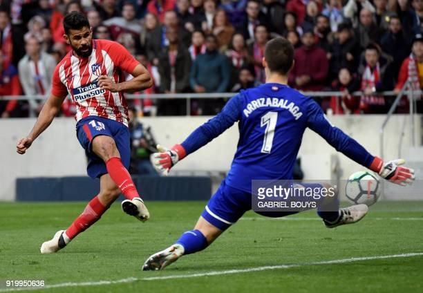 Atletico Madrid's Spanish forward Diego Costa shoots to score a goal during the Spanish league football match between Club Atletico de Madrid vs...