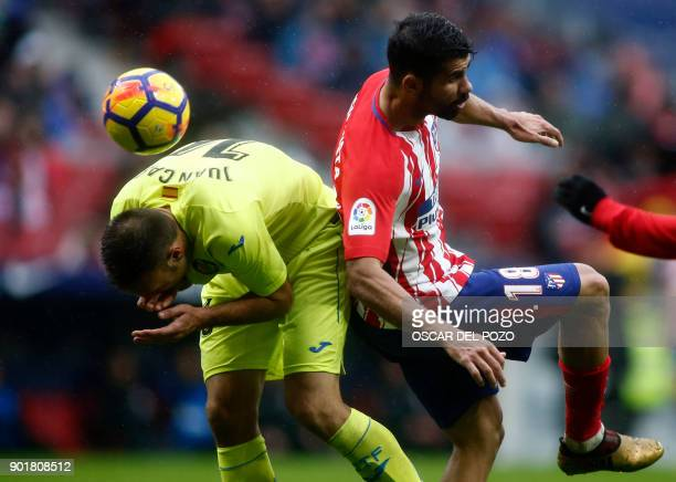 Atletico Madrid's Spanish forward Diego Costa vies with Getafe's defender Juan Cala during the Spanish league football match Club Atletico de Madrid...