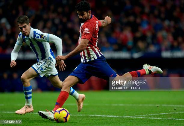 Atletico Madrid's Spanish forward Diego Costa vies with Real Sociedad's Spanish defender Aritz Elustondo during the Spanish league football match...