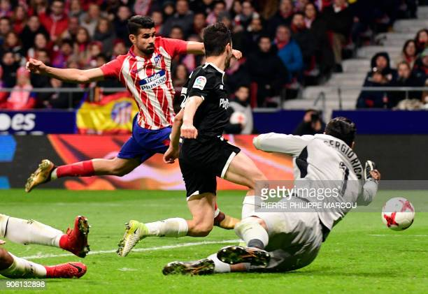 Atletico Madrid's Spanish forward Diego Costa vies with Sevilla's Spanish goalkeeper Sergio Rico Gonzalez during the Spanish 'Copa del Rey' football...