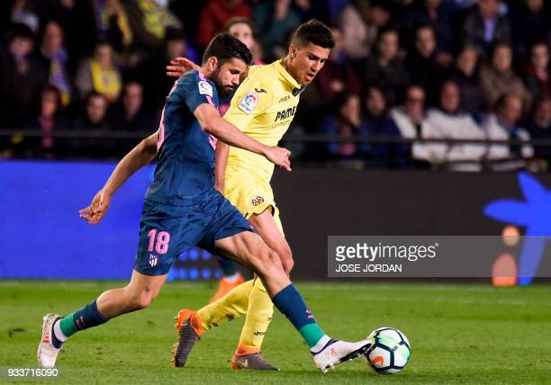 Atletico Madrid's Spanish forward Diego Costa vies with Villarreal's Spanish midfielder Rodrigo Hernandez during the Spanish League football match...