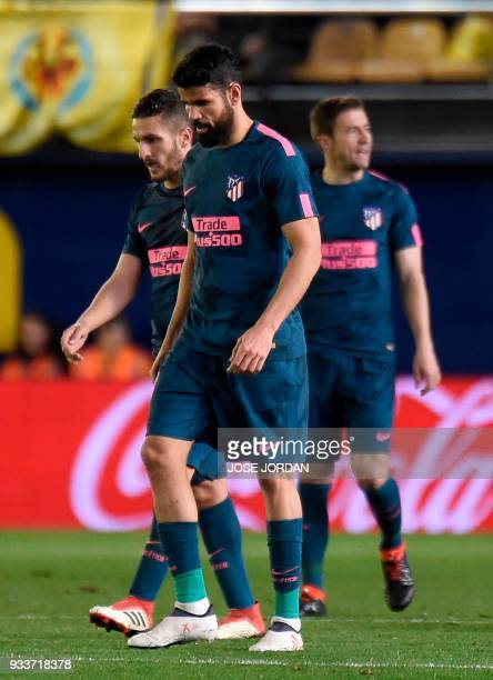 Atletico Madrid's Spanish forward Diego Costa walks on the pitch after Villarreal's goal during the Spanish League football match between Villarreal...