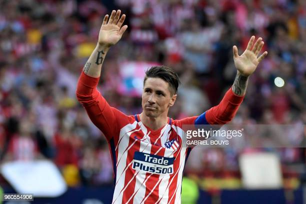 Atletico Madrid's Spanish forward Fernando Torres acknowledges fans at the end of the Spanish league football match between Club Atletico de Madrid...