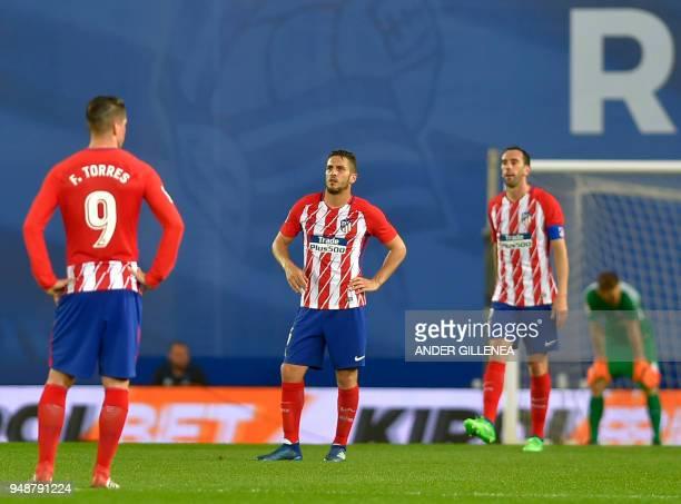Atletico Madrid's Spanish forward Fernando Torres Atletico Madrid's Spanish midfielder Koke and Atletico Madrid's Uruguayan defender Diego Godin...
