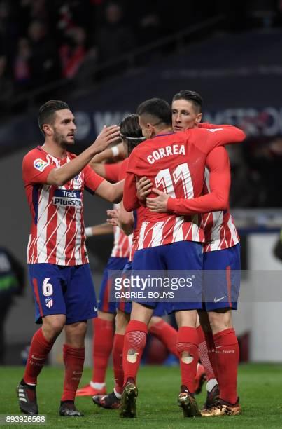Atletico Madrid's Spanish forward Fernando Torres celebrates a goal with teammates during the Spanish league football match Club Atletico de Madrid...