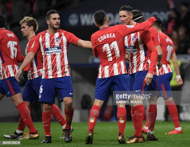 Atletico Madrid's Spanish forward Fernando Torres celebrates a goal with teammates during the Spanish league football match Club Atletico de Madrid...