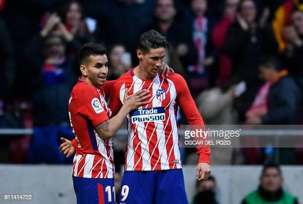 Atletico Madrid's Spanish forward Fernando Torres celebrates a goal with Atletico Madrid's Argentinian forward Angel Correa during the Spanish league...