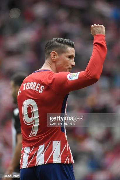 Atletico Madrid's Spanish forward Fernando Torres celebrates a goal during the Spanish league football match between Club Atletico de Madrid and...