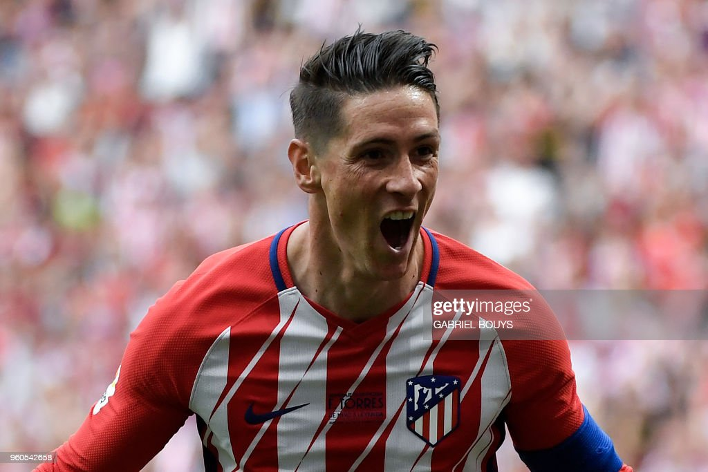 Atletico Madrid's Spanish forward Fernando Torres celebrates after scoring a goal during the Spanish league football match between Club Atletico de Madrid and SD Eibar at the Wanda Metropolitano stadium in Madrid on May 20, 2018.