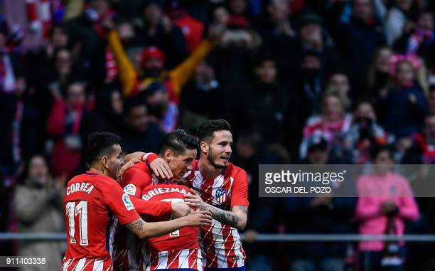 Atletico Madrid's Spanish forward Fernando Torres celebrates with teammates after scoring a goal during the Spanish league football match between...