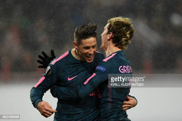 Atletico Madrid's Spanish forward Fernando Torres celebrates with Atletico Madrid's French forward Antoine Griezmann after scoring the team's fourth...