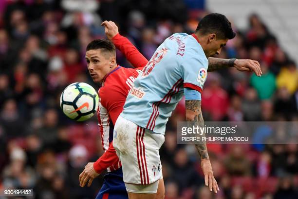 Atletico Madrid's Spanish forward Fernando Torres challenges Celta Vigo's Chilean midfielder Pedro Pablo Hernandez during the Spanish league football...