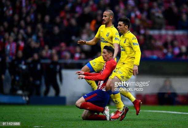 Atletico Madrid's Spanish forward Fernando Torres scores a goal during the Spanish league football match between Club Atletico de Madrid and UD Las...