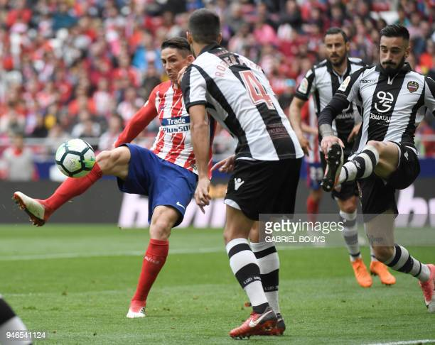 Atletico Madrid's Spanish forward Fernando Torres shoots to score a goal during the Spanish league football match between Club Atletico de Madrid and...