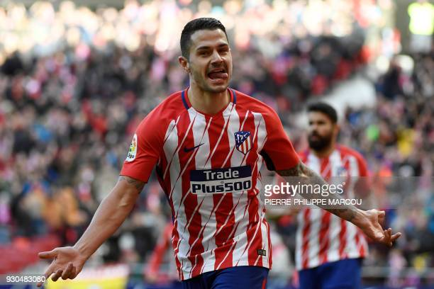 Atletico Madrid's Spanish forward Vitolo celebrates after scoring a goal during the Spanish league football match between Atletico Madrid and Celta...