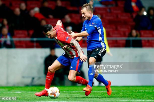 Atletico Madrid's Spanish forward Vitolo challenges FC Copenhagen's Swedish defender Pierre Bengtsson during the Europa League Round of 32 second leg...