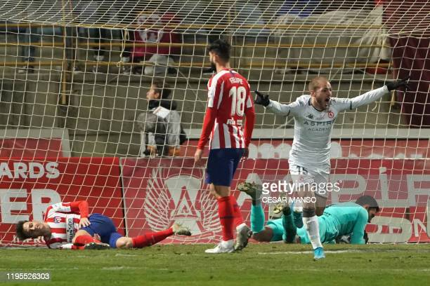 Atletico Madrid's Spanish goalkeeper Antonio Adan fails to stop a ball kicked by Cultural Leonesa's Julen Castaneda during the Copa del Rey football...