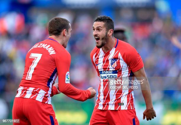 Atletico Madrid's Spanish midfield Koke celebrates a goal with Atletico Madrid's French forward Antoine Griezmann during the Spanish league football...