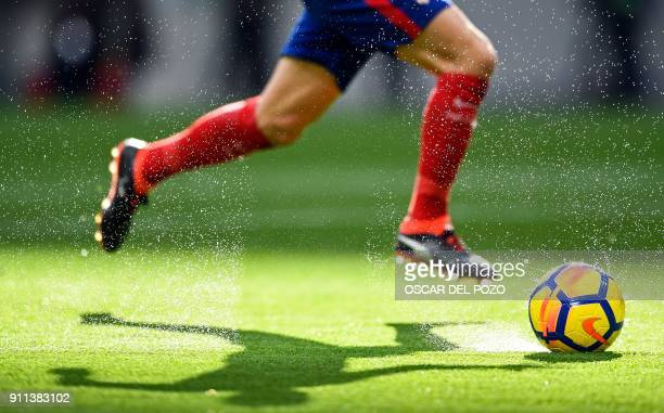 TOPSHOT Atletico Madrid's Spanish midfielder Gabi controls the ball during the Spanish league football match between Club Atletico de Madrid and UD...