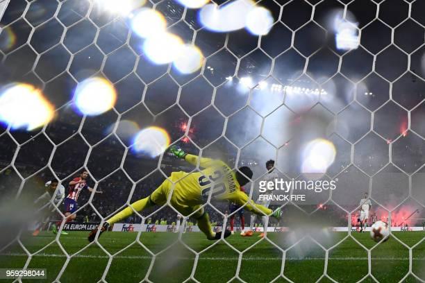 Atletico Madrid's Spanish midfielder Gabi scores the third goal past Marseille's French goalkeeper Steve Mandanda during the UEFA Europa League final...
